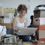 female shopaholic with laptop shopping online in messy 3791614